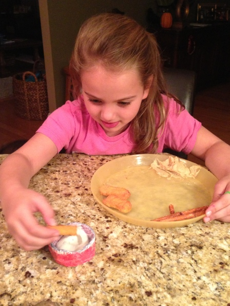 One little Brownie using her handmade bowl at suppertime...