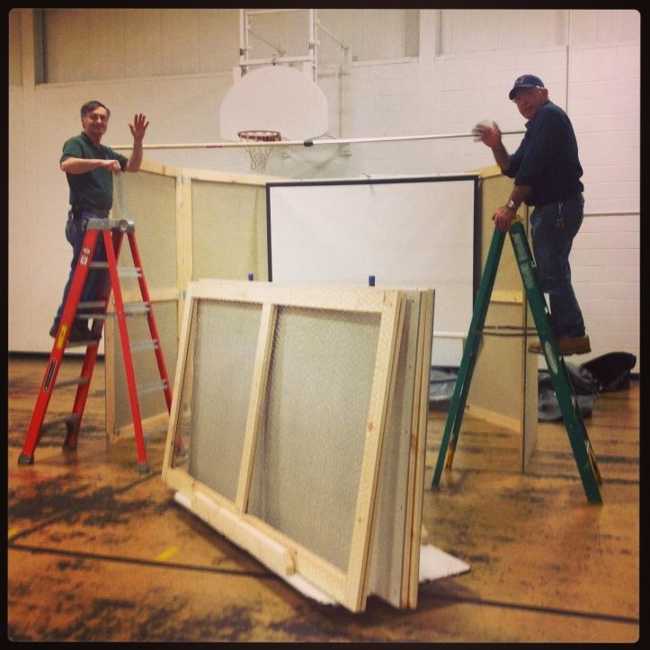 """Our maintenance staff setting up the """"projection booth""""..."""