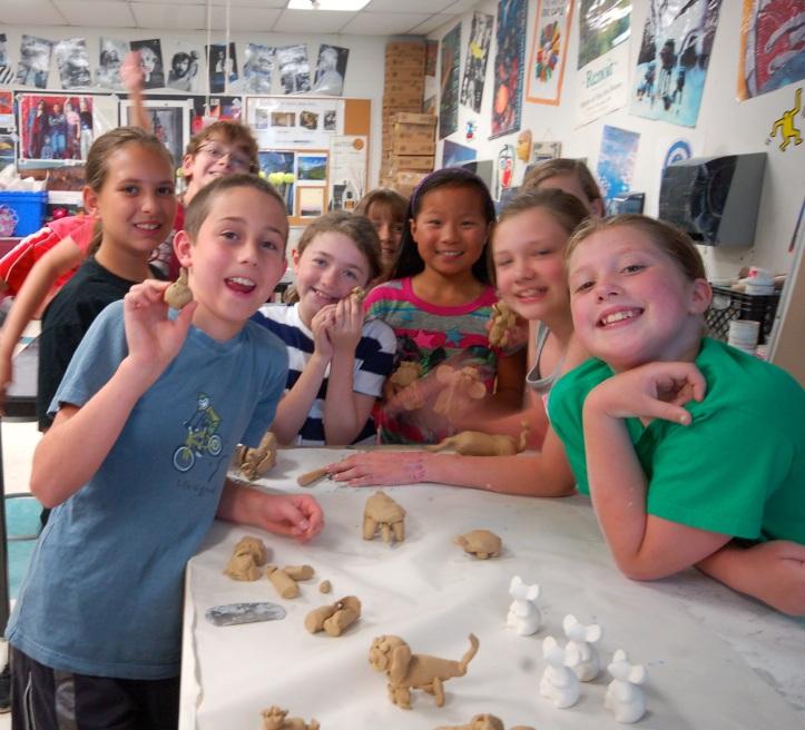 Gathered around the plastiline modeling clay...
